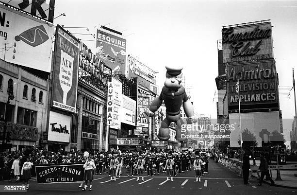 A Thanksgiving parade in New York Floating above the majorettes is a giant inflatable Popeye