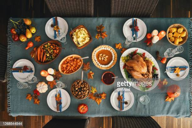 thanksgiving party table setting traditional holiday stuffed turkey dinner - thanksgiving holiday stock pictures, royalty-free photos & images
