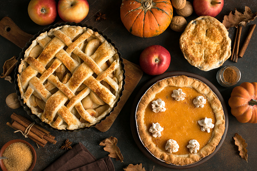 Thanksgiving pumpkin and apple various pies 1033295472