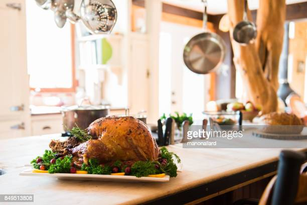 thanksgiving roast turkey garnish and platter on rustic wooden table - canadian thanksgiving stock pictures, royalty-free photos & images