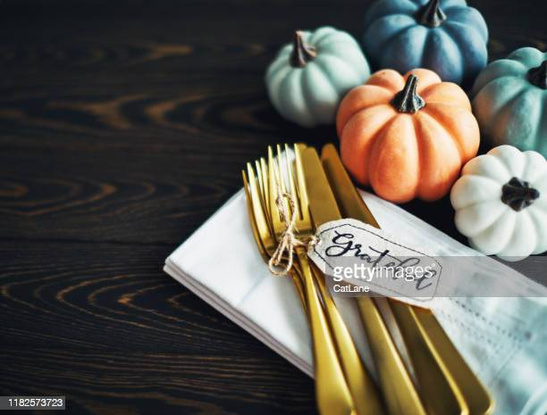thanksgiving table setting background with pumpkins and gold cutlery - gratitude stock pictures, royalty-free photos & images
