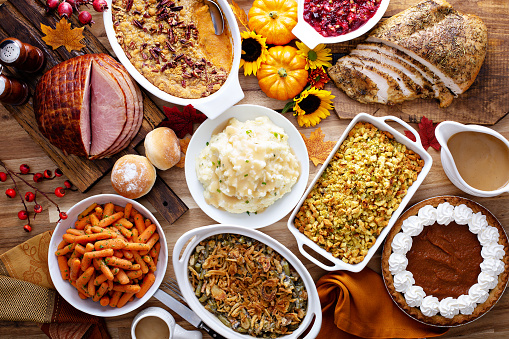 Thanksgiving table with turkey and sides 1036967058