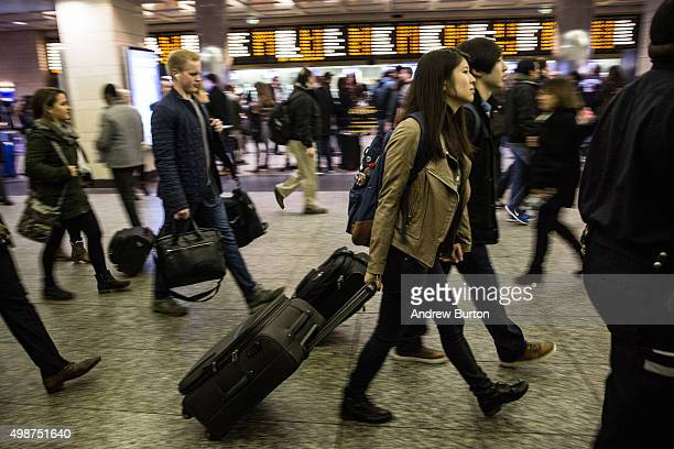 Thanksgiving travelers pack Penn Station on November 25 2015 in New York United States Security has been heightened in major US cities going into the...