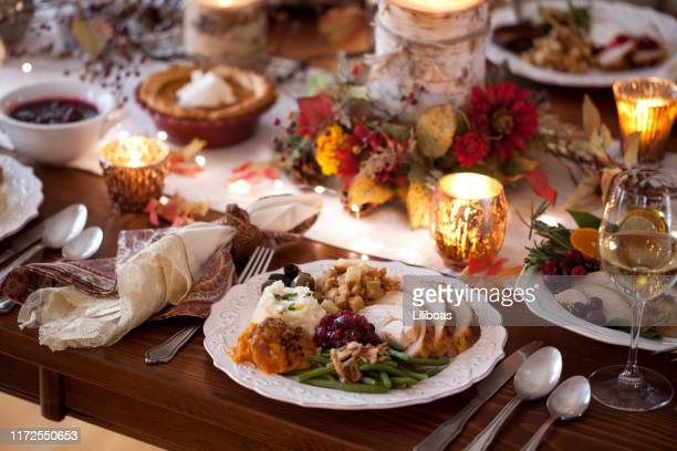 thanksgiving turkey dinner - thanksgiving plate of food stock pictures, royalty-free photos & images
