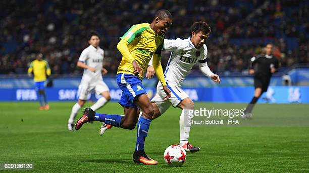 Thapelo Morena of Mamelodi Sundowns takes on Atsutaka Nakamura of Kashima Antlers during the FIFA Club World Cup second round match between Mamelodi...