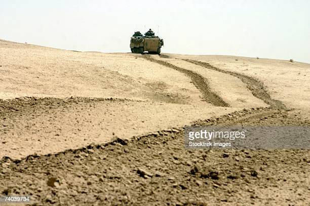 Thar Thar Region, Iraq In the distance, an amphibious assault vehicle rolls through a desert field north of Fallujah June 21.