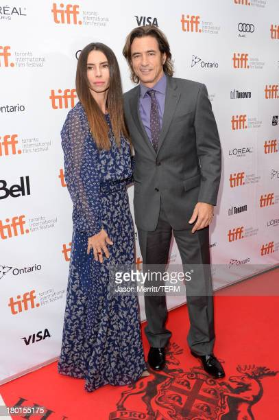 Tharita Catulle and actor Dermot Mulroney arrive at the August Osage County Premiere during the 2013 Toronto International Film Festival at Roy...