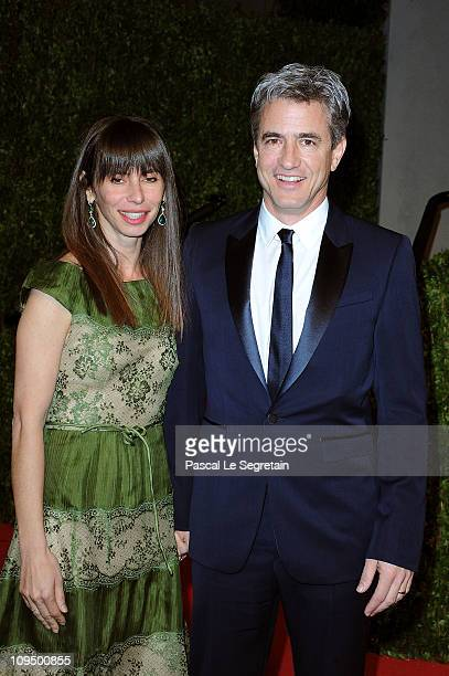 Tharita Catulle and actor Dermot Mulroney arrive at the Vanity Fair Oscar party hosted by Graydon Carter held at Sunset Tower on February 27 2011 in...