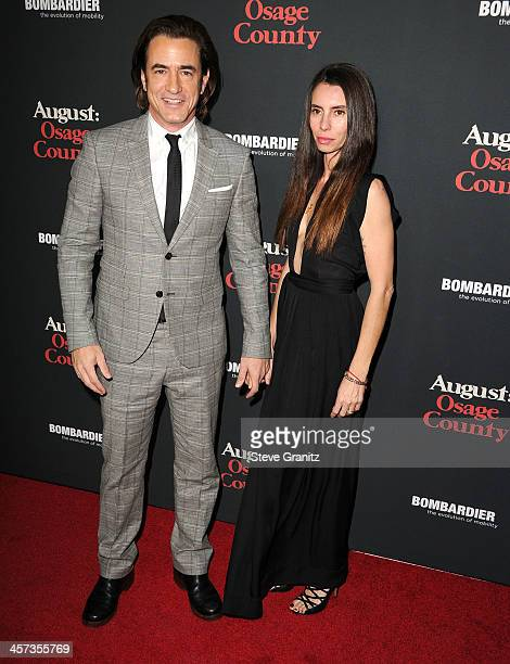 Tharita Catulle and Dermot Mulroney arrives at the August Osage County Los Angeles Premiere at Regal Cinemas LA Live on December 16 2013 in Los...