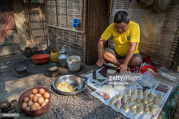 Tharka Mang Rai 35 years old prepares Samosas in his shop in Beldangi 2 refugee camp on March 13 2015 in Beldangi Nepal Tharka arrived in 1990 in the...