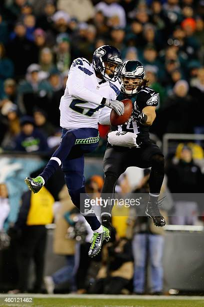 Tharold Simon of the Seattle Seahawks intercepts a pass intended for Riley Cooper of the Philadelphia Eagles during the second half of the game at...