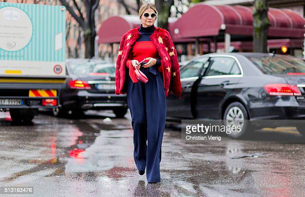 Thassia Naves is wearing a red fur jacket and a navy jumpsuit seen outside Giorgio Armani during Milan Fashion Week Fall/Winter 2016/17 on February...