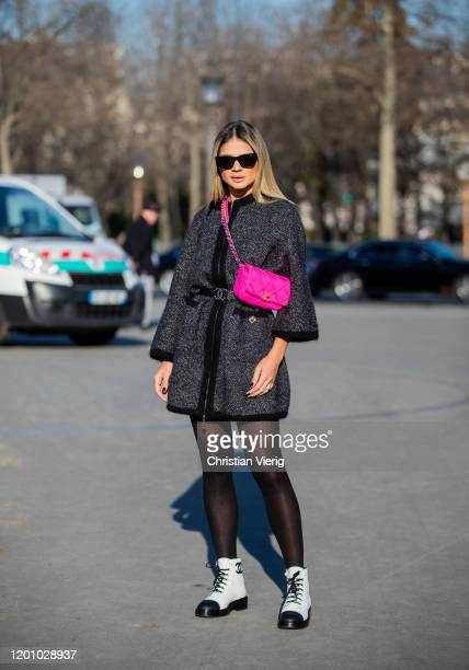 Thassia Naves seen wearing pink Chanel bag grey coat sheer tights outside Chanel during Paris Fashion Week Haute Couture Spring/Summer 2020 on...