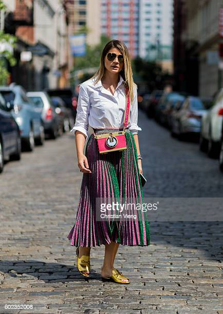 Thassia Naves wearing a Dolce Gabbana bag and Carven shoes and Gig Couture skirt outside Rebecca Minkoff on September 10 2016 in New York City
