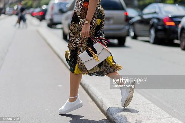 Thassia Naves wearing a Isabela Capeto dress and a Gucci bag outside Jean Paul Gaultier during Paris Fashion Week Haute Couture F/W 2016/2017 on July...