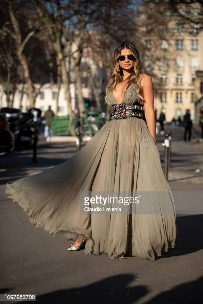 Thassia Naves wearing a long military green dress with a decorated belt and Dior bag is seen outside Christian Dior during Paris Fashion Week Haute...