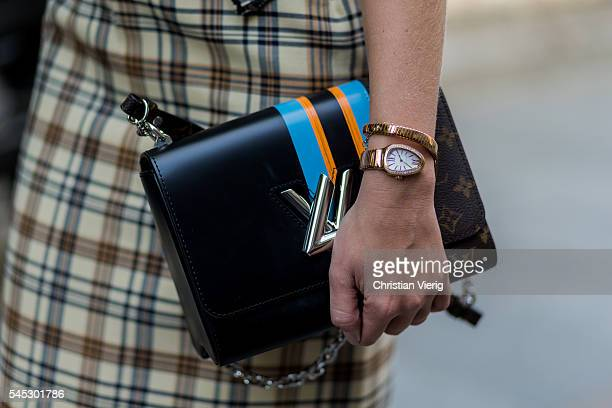 Thassia Naves wearing a plaid dress from A La Garconne and Louis Vuitton bag outside Viktor Rolf during Paris Fashion Week Haute Couture F/W...