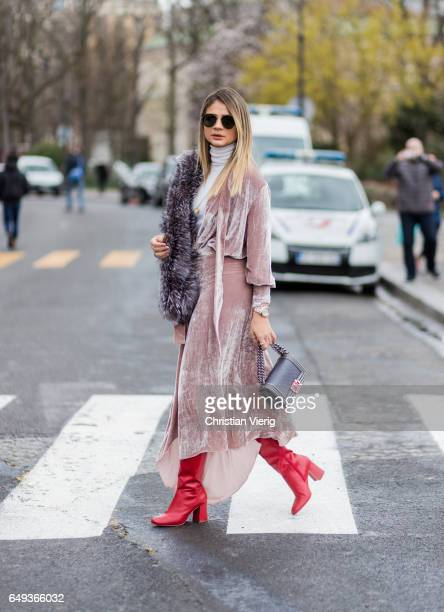 Thassia Naves wearing a velvet dress fur scarf red overknees outside Chanel on March 7 2017 in Paris France