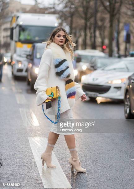 Thassia Naves wearing a yellow coat white knit outside Rochas on March 1 2017 in Paris France