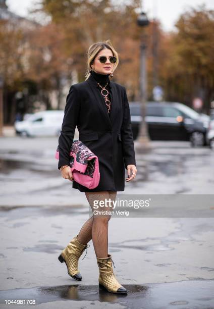 Thassia Naves wearing Chanel bag golden boots black turtleneck golden necklace black blazer tights is seen outside Chanel during Paris Fashion Week...