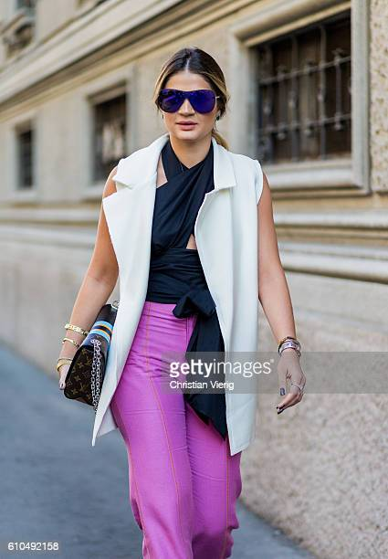 Thassia Naves wearing pink pants outside Ferragamo during Milan Fashion Week Spring/Summer 2017 on September 25 2016 in Milan Italy