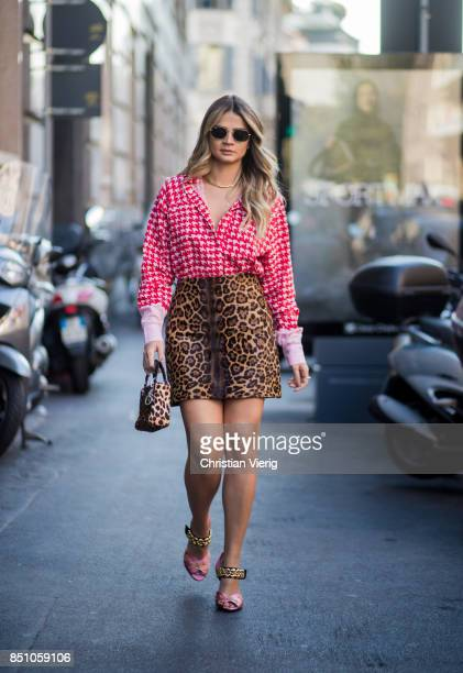 Thassia Naves wearing skirt with leo print blouse Dior bag with leo print is seen outside Max Mara during Milan Fashion Week Spring/Summer 2018 on...