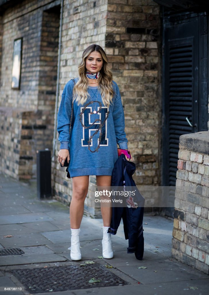 Thassia Naves wearing sweater dress outside Tommy Hilfiger during London Fashion Week September 2017 on September 19, 2017 in London, England.