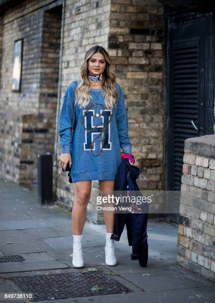 Thassia Naves wearing sweater dress outside Tommy Hilfiger during London Fashion Week September 2017 on September 19 2017 in London England