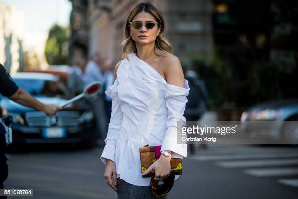 Thassia Naves wearing white blouse is seen outside Prada during Milan Fashion Week Spring/Summer 2018 on September 21 2017 in Milan Italy