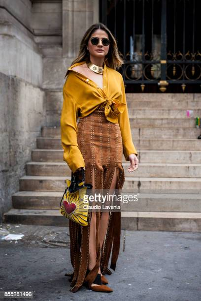 Thassia Naves wearing yellow blouse is seen before the Balmain fashion show during Paris Fashion week Womenswear SS18 on September 28 2017 in Paris...