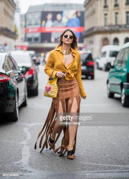 Thassia Naves wearing yellow blouse is seen outside Balmain during Paris Fashion Week Spring/Summer 2018 on September 28 2017 in Paris France