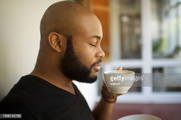that coffee just smells soo good - smelling stock pictures, royalty-free photos & images