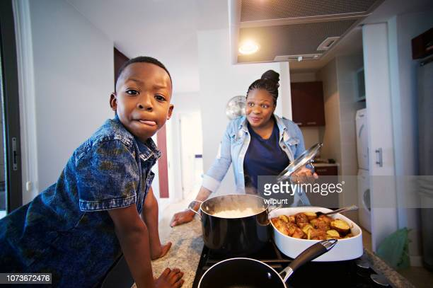 that looks scrumptious; boy licking lips - south african culture stock photos and pictures