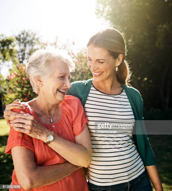 that mother daughter bond...the gift that keeps on giving - mother daughter stock photos and pictures