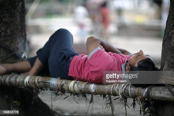 That same spot, its great to see so many different people taking a nap there.... From inside the car on my way to school. Nor Ahmed Road, Chittagong