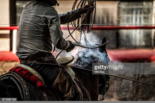 That smoke is the result of heat generated by the rope wound around the saddle horn actually burning through the horn