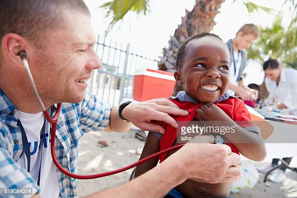 that tickles! - charity and relief work stock pictures, royalty-free photos & images