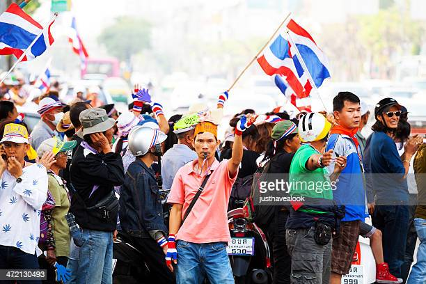 that way gesturing demonstrant in bangkok - demonstrant stock pictures, royalty-free photos & images