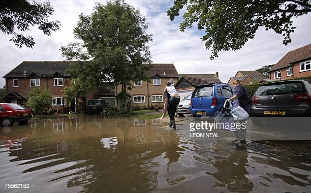 Residents return to their home 21 July 2007 following the flash floods that hit the Berkshire area 20 July Thatcham Britain Helicopters rescued...