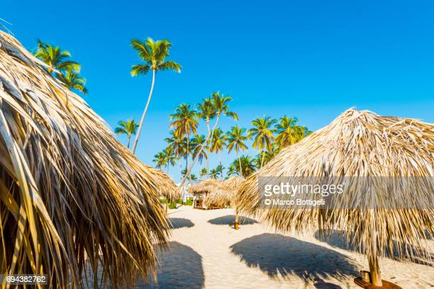Thatched beach umbrella on tropical beach.