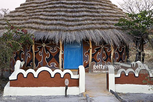 Thatched hut painted with traditionally styled Bakalanga decorative designs. Planet Baobab, Botswana. (PR: Property Released)