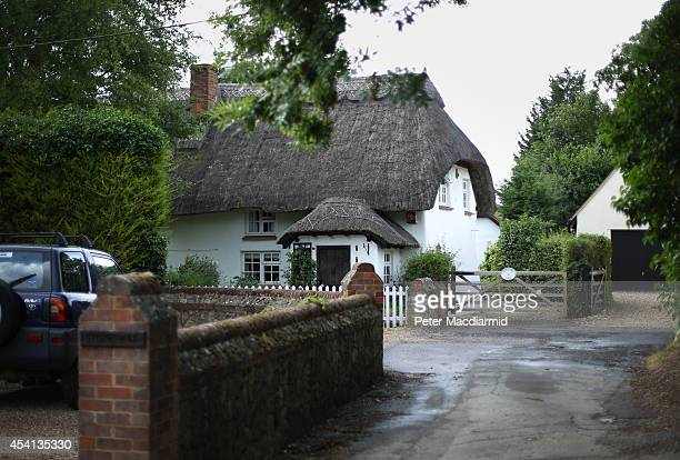 A thatched roof dominates a cottage on July 29 2013 in Gibraltar England Residents say the tiny hamlet originally called Little Worth was renamed...