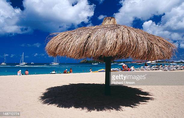 Thatched umbrella on Reduit Beach at Rodney Bay.