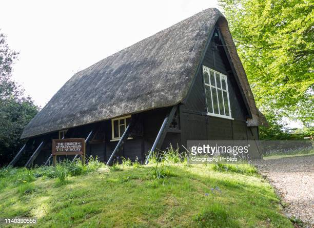 Thatched wooden church of St Mary and St Nicholas village parish church Sandy Lane Wiltshire England UK