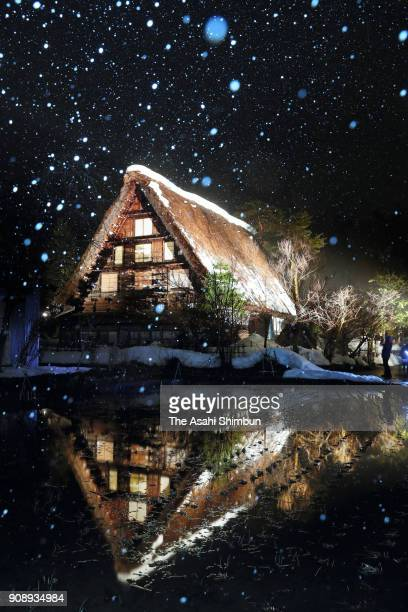 A thatchedroof 'gasshozukuri' house is illuminated in the World Heritage village of Shirakawago on January 21 2018 in Shirakawa Gifu Japan The...