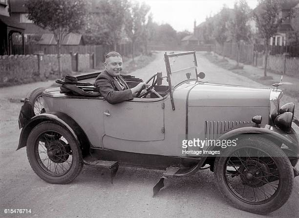 FA Thatcher behind the wheel of a 1929 Triumph Super Seven open fourseater Triumph Super Seven 1929 832 cc Driver Thatcher FA Open 4seater Artist...