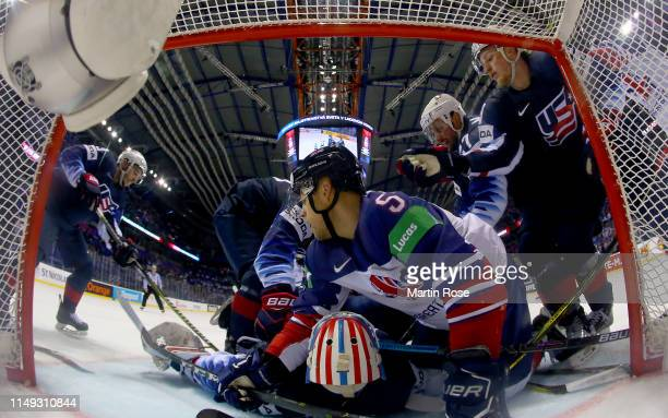 Thatcher Demko, goaltender of United States tends net against Ben Davies of Great Britain during the 2019 IIHF Ice Hockey World Championship Slovakia...