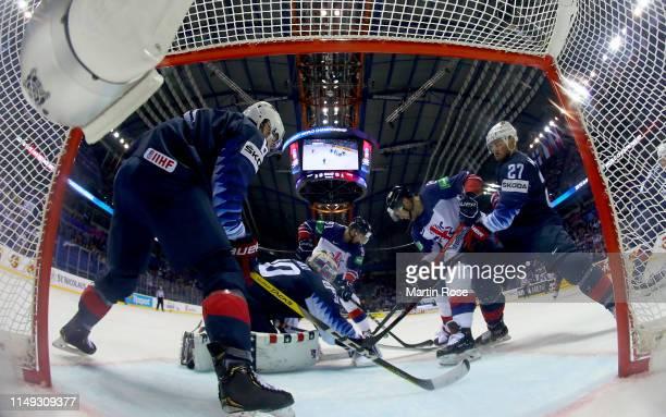 Thatcher Demko, goaltender of United States tends net against Matthew Myers of Great Britain during the 2019 IIHF Ice Hockey World Championship...