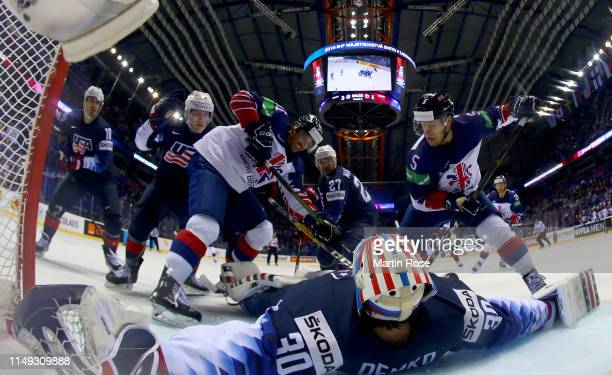 Thatcher Demko, goaltender of United States tends net against Matthew Myers and Ben Lake of Great Britain during the 2019 IIHF Ice Hockey World...