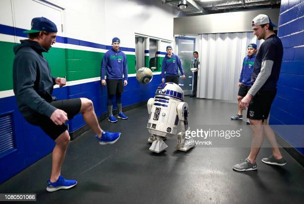 Thatcher Demko looks on as Sven Baertschi of the Vancouver Canucks kicks the soccer ball to R2D2 before their NHL game against the Arizona Coyotes on...